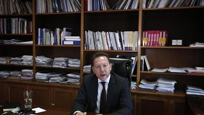 Greece's Finance Minister Stournaras speaks during an interview in Athens