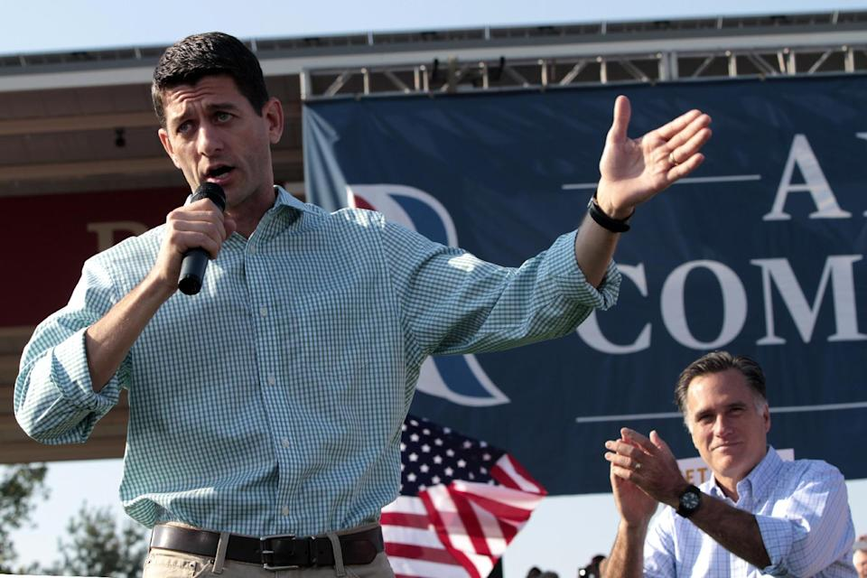 Republican presidential candidate, former Massachusetts Gov. Mitt Romney, claps as Republican vice presidential candidate, Rep. Paul Ryan, R-Wis., speaks during a campaign event at the Village Green Park, Saturday, Aug. 25, 2012 in Powell, Ohio.  (AP Photo/Mary Altaffer)