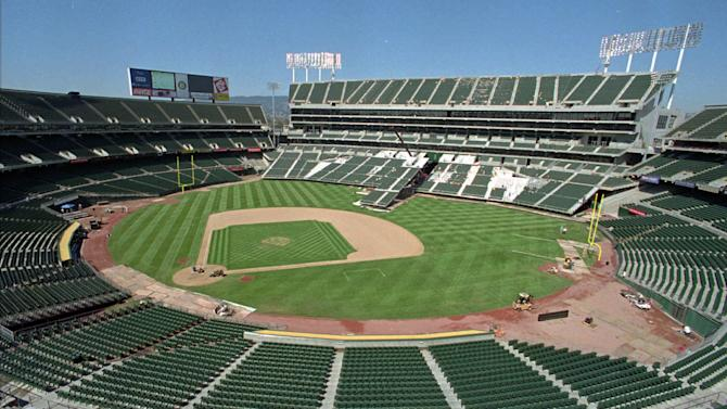 FILE -- This Aug. 7, 1996, file photo, shows the Oakland Coliseum in transition from baseball to football field configuration in Oakland, Calif. Oakland is desperately trying to keep the team from moving out of a city already struggling with crime, financial woes and blow after blow to its public image. To the south in the heart of booming Silicon Valley, San Jose is seeking to bolster its profile and treasury with an aggressive campaign to win the A's, including a legal challenge to Major League Baseball's sacrosanct antitrust exemption that the mayor vows to take to the U.S. Supreme Court if necessary. Standing in the way are San Francisco's Giants, who claim the lucrative Silicon Valley commercial market as their exclusive territory. And so far, the Giants are winning. (AP Photo/Ben Margot, File)