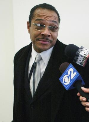 FILE - In this Feb. 1, 2004 file photo, Calvin Hollins Jr., co-owner of the E2 nightclub on Chicago's South Side where 21 people were killed during a stampede in 2003, speaks with reporters outside Cook County Housing Court in Chicago. In a ruling Thursday, April 4, 2013, the Illinois Supreme Court reversed an appellate court's decision tossing the guilty verdicts and vacating the sentences of Hollins and co-owner Dwain Kyles. Hollins and Kyles were convicted in 2009 and sentenced to two years for violating a judge's order to close the second floor of the club before the stampede. (AP Photo/Nam Y. Huh, File)