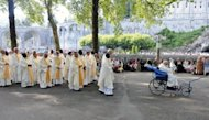 Catholics take part in a procession during a mass to celebrate the Feast of the Assumption in the Sectuary of Our Lady in the French southwestern pilgrimage city of Lourdes