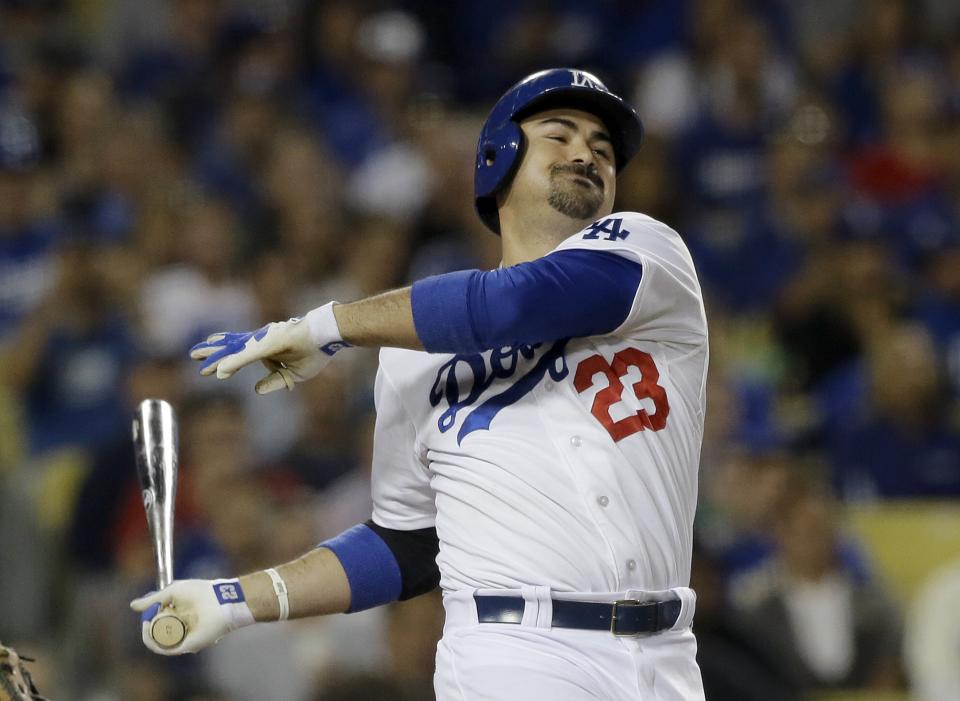Los Angeles Dodgers' Adrian Gonzalez strikes out swinging against the Washington Nationals in the third inning of a baseball game in Los Angeles Tuesday, May 14, 2013. (AP Photo/Reed Saxon)
