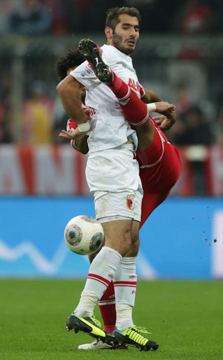 Bayern's Dante of Brazil, background, and Augsburg's Halil Altintop of Turkey challenge for the ball during the German first division Bundesliga soccer match between FC Bayern Munich and FC Augsburg,