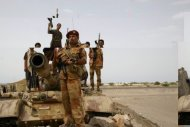 Yemeni troops on patrol between the provincial capital Zinjibar and the town of Jaar in June 2012. A suicide bombing in south Yemen blamed on Al-Qaeda killed 45 people, local officials said on Sunday, as residents voiced fears that a lack of security personnel on the ground will allow the jihadists to return