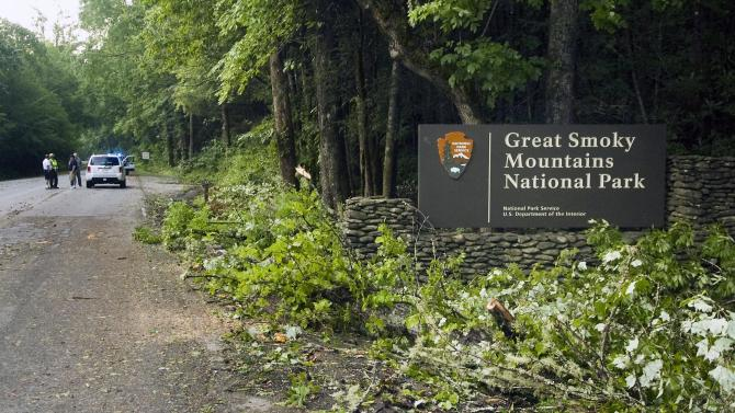 Branches torn from trees lie at an entrance to the Great Smoky Mountains National Park Friday, July 6, 2012, in Townsend, Tenn., following a violent storm that swept through the Cades Cove area Thursday evening, killing at least two park visitors and injuring others. (AP Photo/The Knoxville News Sentinel, J. Miles Cary)