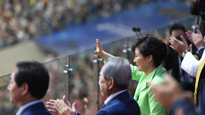 South Korean President Park Geun-hye (R) waves during the opening ceremony of the Asian Games at the Incheon stadium  on September 19, 2014