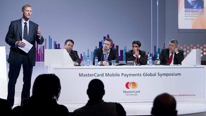 IMAGE DISTRIBUTED FOR MASTERCARD - From left, Brian Lang (MasterCard), George Held (Etisalat), Nick Dent (Ooredoo), Srinivas Nidugondi (Mahindra Comviva) and Jayant Khosla (airtel) at the MasterCard Mobile Payments Symposium discussing the future of mobile payments in the Middle East and Africa at the Mobile World Congress on Tuesday, Feb. 26, 2013 in Barcelona. (Marcel-li Saenz Martinez/AP Images for MasterCard)