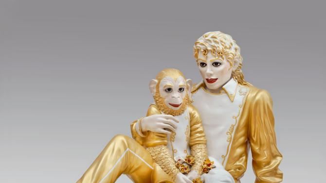"""This photo provided by the Metropolitan Museum of Art shows Jeff Koons' porcelain """"Michael Jackson and Bubbles,"""" in the museum's new exhibition """"Regarding Warhol: Sixty Artists, Fifty Years.""""  The exhibition begins Tuesday, Sept. 18, 2012, and runs through Dec. 31. (AP Photo/Metropolitan Museum of Art)"""