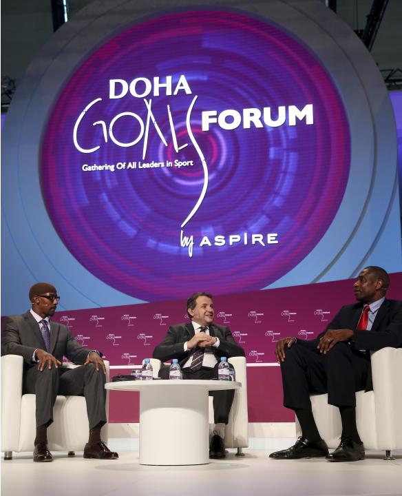 Al-Jazeera Sport Channel presenter Fadel speaks to former NFL player Abdullah and former NBA player Mutombo during the Doha GOALS forum in Doha
