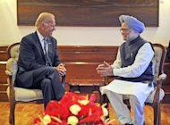 Indian Prime Minister Manmohan Singh talks with US Vice President Joe Biden in New Delhi, on July 23, 2013. Biden is expected Wednesday to urge India to further open its doors to foreign investment, during his visit to boost bilateral ties between the world's two largest democracies