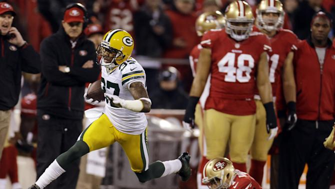 Green Bay Packers cornerback Sam Shields (37) returns an interception for a touchdown as he dives past San Francisco 49ers quarterback Colin Kaepernick (7) during the first quarter of an NFC divisional playoff NFL football game in San Francisco, Saturday, Jan. 12, 2013. (AP Photo/Ben Margot)