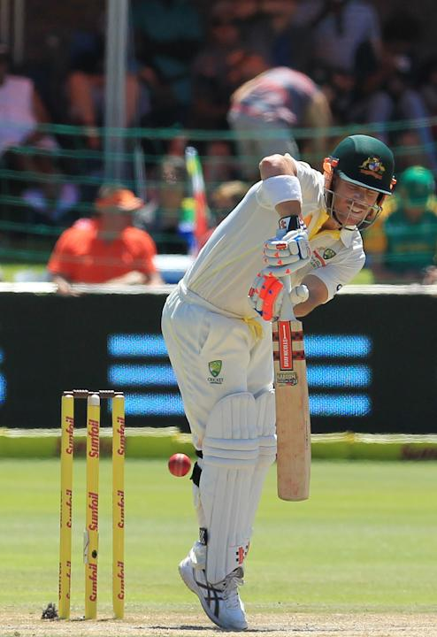 Australia's batsman David Warner plays a shot on the fourth day of their 2nd cricket test match against South Africa at St George's Park in Port Elizabeth, South Africa, Sunday, Feb. 23, 2014.