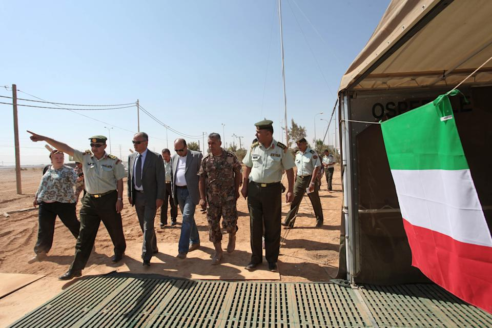 Francesco Fransoni, Italian ambassador to Jordan, third from left, walks with Jordanian military officers and medical officials as he tours the Italian Field Hospital for Syrian refugees, which was established in al-Mafraq city, Jordan, Tuesday, July 10, 2012. (AP Photo/Mohammad Hannon)