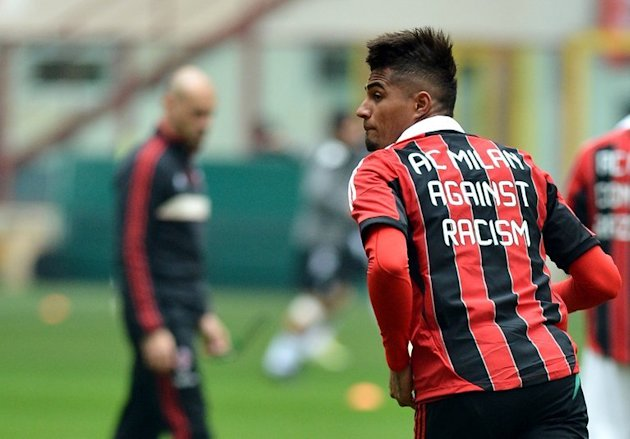 AC Milan's Kevin Prince Boateng warms up wearing a jersey against racism on January 6 , 2013 in Milan