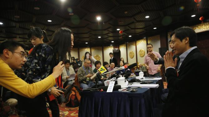 Lei Jun, founder and chief executive officer of China's mobile company Xiaomi Inc, acknowledges reporters at a news conference which was held as part of the National People's Congress, the country's parliament, in Beijing