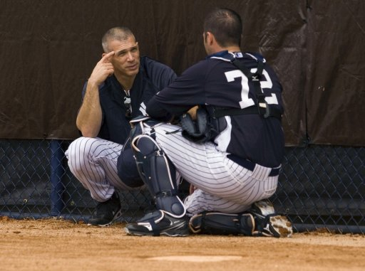 New York Yankees manager Girardi talks with catcher Romine during a workout in Tampa