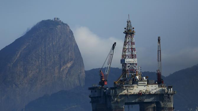 An oil platform is pictured in Guanabara Bay with the Sugar Loaf Mountain in the background in Niteroi