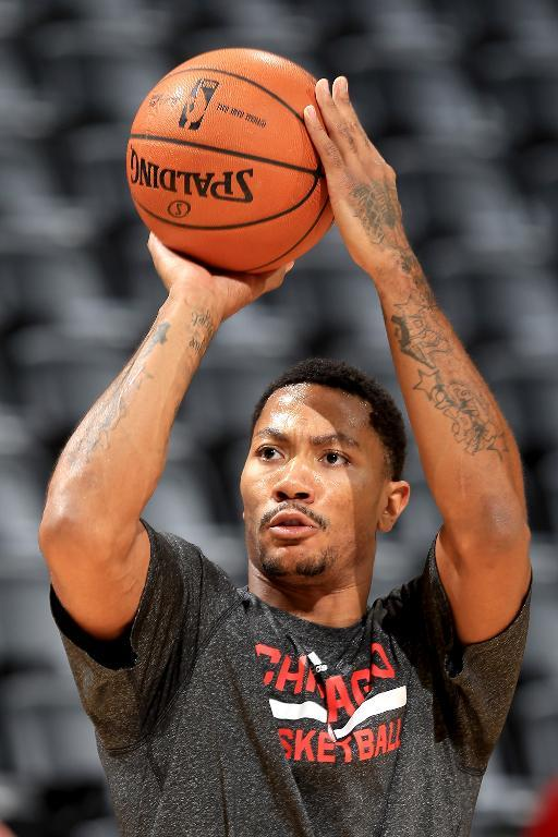 Derrick Rose of the Chicago Bulls warms up prior to playing the Denver Nuggets, at Pepsi Center in Denver, Colorado, on November 21, 2013