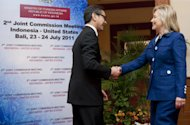 Indonesian Foreign Minister Marty Natalegawa, left, shakes hands with U.S. Secretary of State Hillary Rodham Clinton as she arrives for their Joint Commission Meeting Indonesia-U.S. in Nusa Dua on Indonesia's resort island of Bali, Sunday, July 24, 2011. (AP Photo/Saul Loeb, Pool)
