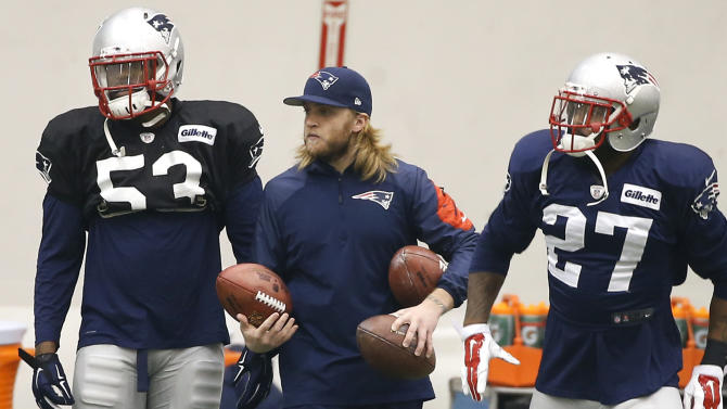 In this Jan. 22, 2015, file photo, New England Patriots coaching assistant Steve Belichick holds footballs as strong safety Tavon Wilson (27) and linebacker Eric Martin (53) prepare for NFL football practice in Foxborough, Mass. Belichick's father, Mike Belichick, is coach of the team. Steve Belichick was a lacrosse player at Rutgers before walking on the football team as a long snapper