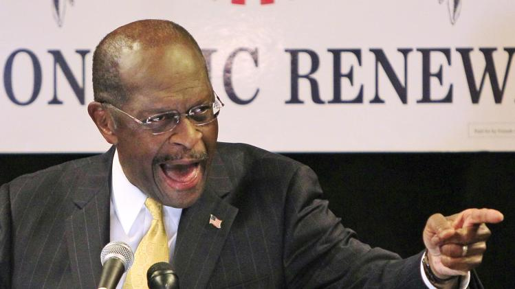 "Republican presidential candidate, Herman Cain makes a point during a speech at a campaign rally, Wednesday, Nov. 30, 2011, in Dayton, Ohio. Cain claimed a ""groundswell of positive support"" from backers for his presidential campaign. (AP Photo/Al Behrman)"