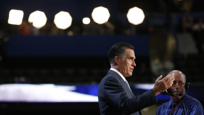 Republican presidential nominee Mitt Romney looks over the podium during a sound check at the Republican National Convention in Tampa, Fla., on Thursday, Aug. 30, 2012.  (AP Photo/Jae C. Hong)