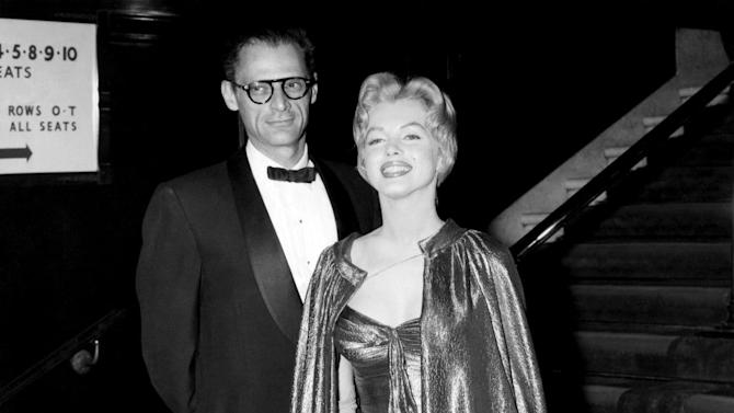 """In this late October 1956 publicity photo provided by Running Press, Marilyn Monroe, right, with husband Arthur Miller, is shown in the final weeks of filming """"The Prince and the Showgirl."""" This goddess-like ensemble is in a burnished gold lamé. (AP Photo/Courtesy Running Press)"""