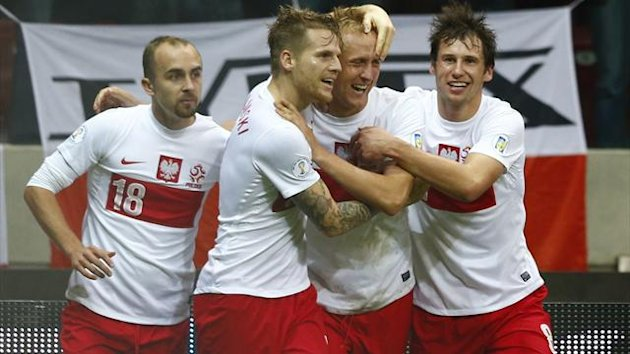 Poland celebrate their equalising goal