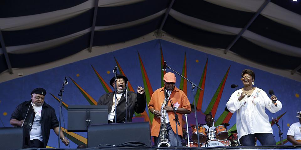 Irma Thomas, right, performs at the New Orleans Jazz and Heritage Festival in New Orleans, Sunday, May 5, 2013. (AP Photo/Gerald Herbert)