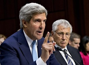 Defense Secretary Chuck Hagel listens at right as Secretary …