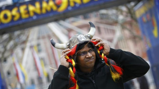 Tourist braves the wind after Rosenmontag parade cancelled in Mainz