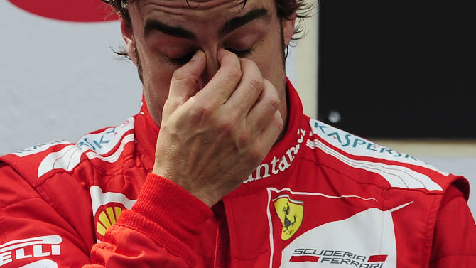 Ferrari Formula One driver, Fernando Alonso, from Spain, reacts after his second place at the end of Spanish Grand Prix at the Montmelo racetrack near Barcelona, Sunday May 13, 2012. Venezuelan's Pastor Maldonado won the race. (AP Photo/Manu Fernandez)