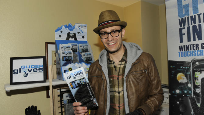Musician Erick Macek visits Glider Gloves at the Fender Music lodge during the Sundance Film Festival on Monday, Jan. 21, 2013, in Park City, Utah. (Photo by Jack Dempsey/Invision for Fender/AP Images)