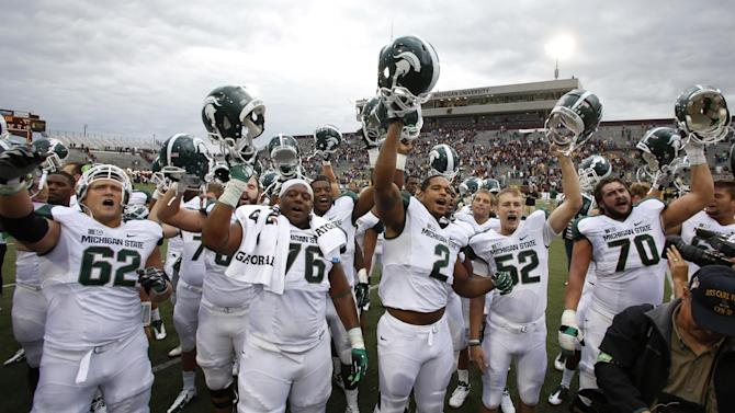 Michigan State players celebrate their 41-7 win over Central Michigan in an NCAA college football game on Saturday, Sept. 8, 2012, in Mount Pleasant, Mich. (AP Photo/Al Goldis)