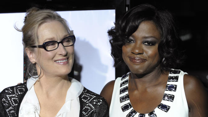 """FILE - In this Nov. 18, 2008 photo, Meryl Streep, left, and Viola Davis, cast members in """"Doubt,"""" pose together at the premiere of the film at the Academy of Motion Picture Arts and Sciences in Beverly Hills, Calif.   Streep has donated $10,000 to a Rhode Island scholarship fund in honor of fellow Oscar nominee Viola Davis. Davis established the fund with her sister in 1988.   (AP Photo/Chris Pizzello)"""