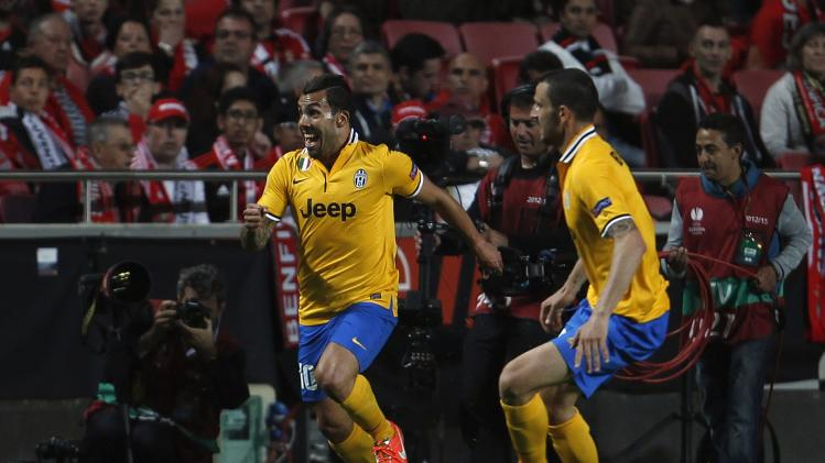 Juventus' Tevez celebrates his goal against Benfica during their Europa League semi-final first leg matchin Lisbon