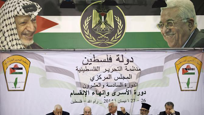 FILE - In this Saturday, April 26, 2014 file photo, Palestinian President Mahmoud Abbas, center, speaks during a meeting with the Palestinian Central Council, a top decision-making body, at his headquarters in the West Bank city of Ramallah. The Palestinians formally join the International Criminal Court on Wednesday, as part of a broader effort to put international pressure on Israel and exact a higher price for its occupation of lands sought for a Palestinian state. (AP Photo/Majdi Mohammed, File)