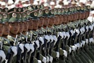 Chinese soldiers take part in a 2004 parade to mark the establishment of new miltary barracks. China has warned that American criticism of its decision to set up a new military garrison in the South China Sea sent the &quot;wrong signal&quot; and threatened peace in the hotly disputed waters