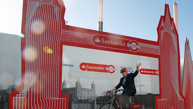 London mayor Boris Johnson rides a bicycle after announcing Santander as the new sponsor for the London Cycle Hire