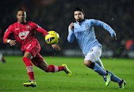 Manchester City striker Sergio Aguero (R) competes with Southampton defender Nathaniel Clyne, on February 9, 2013. City's hopes of retaining their Premier League title were in tatters after a shock 3-1 defeat left manager Roberto Mancini to virtually concede the championship