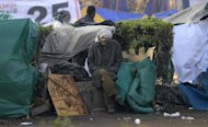 An Egyptian protester sits in Tahrir Square, in Cairo, Egypt, Thursday, Jan. 26, 2012. Egyptian protesters camp in Tahrir Square as they mark the first anniversary of the popular uprising that unseated President Hosni Mubarak. (AP Photo/Khalil Hamra)