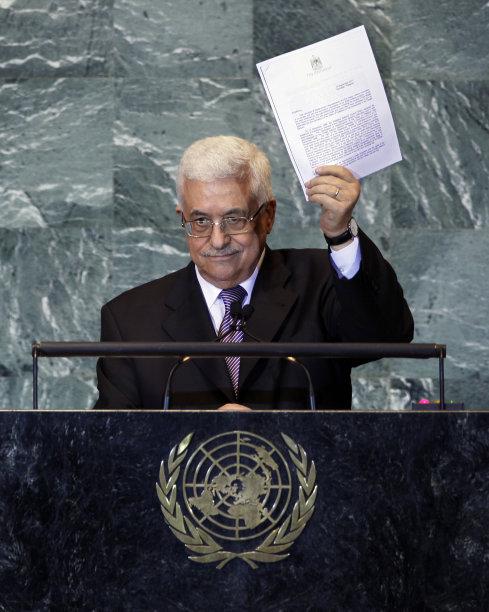 Palestinian President Mahmoud Abbas holds a letter requesting recognition of Palestine as a state as he addresses the 66th session of the United Nations General Assembly, Friday, Sept. 23, 2011 at UN Headquarters. (AP Photo/Richard Drew)