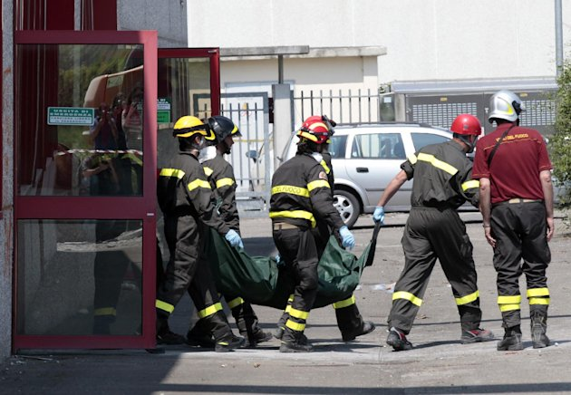 Italian firefighters carry the body of a worker who died in a factory collapse in Medolla, Italy, Wednesday, May 30, 2012. A magnitude 5.8 earthquake struck Tuesday that felled old buildings as well as new factories and warehouses in a swath of Italy north of Bologna. The quake, which followed a May 20 magnitude-6.0 quake in the same area, dealt another blow to one of the country's most productive regions at a time when Italy is struggling to restart its economy. (AP Photo/Gregorio Borgia)