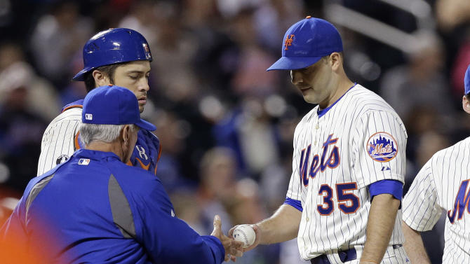 New York Mets starting pitcher Dillon Gee (35) hands the ball to manager Terry Collins as he leaves a baseball game during the seventh inning against The Miami Marlins, Wednesday, Sept. 17, 2014, in New York. (AP Photo/Frank Franklin II)