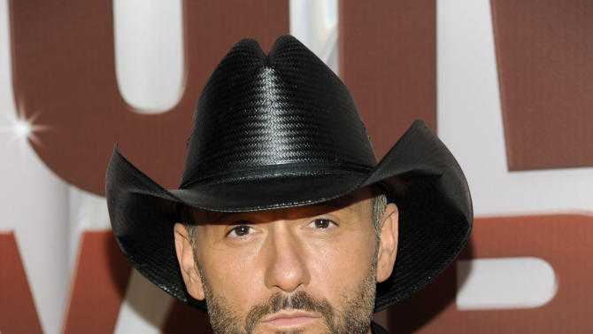 """FILE - In this Nov. 9, 2011 file photo, country singer Tim McGraw arrives at the 45th Annual CMA Awards in Nashville, Tenn.  McGraw announced Tuesday, Oct. 20, 2012, that his first album on Big Machine Records, """"Two Lanes of Freedom,"""" will be released Feb. 5, 2013.  The new single """"One of Those Nights"""" will debut on ABC's live broadcast of the 2012 CMA Awards on Thursday. (AP Photo/Evan Agostini, file)"""
