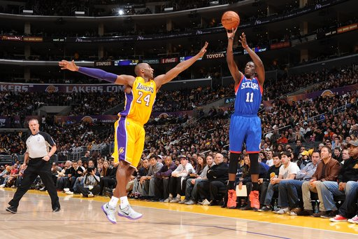 LOS ANGELES, CA - JANUARY 1: Jrue Holiday #11 of the Philadelphia 76ers shoots against Kobe Bryant #24 of the Los Angeles Lakers at Staples Center on January 1, 2013 in Los Angeles, California. (Photo by Andrew D. Bernstein/NBAE via Getty Images)