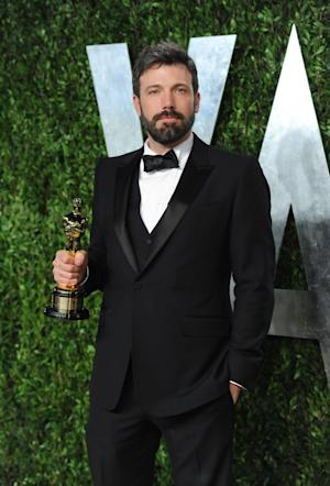 FILE - In this Feb. 24, 2013 photo, actor/director Ben Affleck arrives at the 2013 Vanity Fair Oscars Viewing and After Party, at the Sunset Plaza Hotel in West Hollywood, Calif. Affleck will don Batman's cape and cowl. Warner Bros. announced Thursday, Aug. 22, 2013, that he would star as a new incarnation of the Dark Knight in a film bringing Batman and Superman together. (Photo by Evan Agostini/Invision/AP, File)