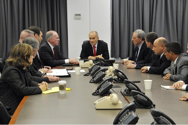 In this photo released by the New York City Police Department, NYC Police Commissioner Raymond Kelly, center, briefs other NYPD officials and John O. Brennan, assistant to the President for Homeland S