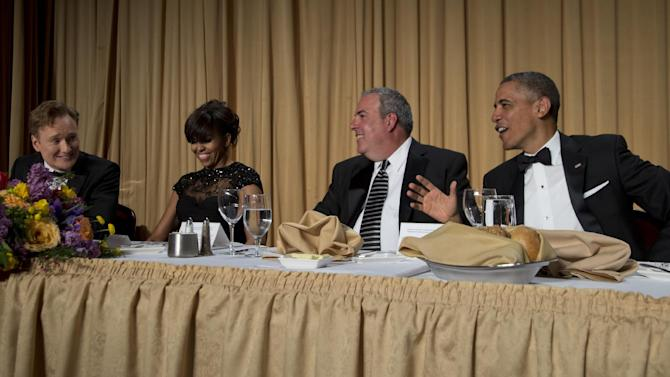 Late-night television host Conan O'Brien, from left, first lady Michelle Obama, Michael Clemente, Executive Vice President of Fox News, and President Barack Obama attend the White House Correspondents' Association Dinner at the Washington Hilton Hotel, Saturday, April 27, 2013, in Washington.  (AP Photo/Carolyn Kaster)