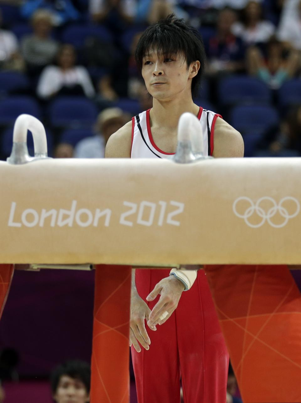Japanese gymnast Kohei Uchimura reacts after slipping off the pommel horse during the Artistic Gymnastics men's qualification at the 2012 Summer Olympics, Saturday, July 28, 2012, in London. (AP Photo/Gregory Bull)
